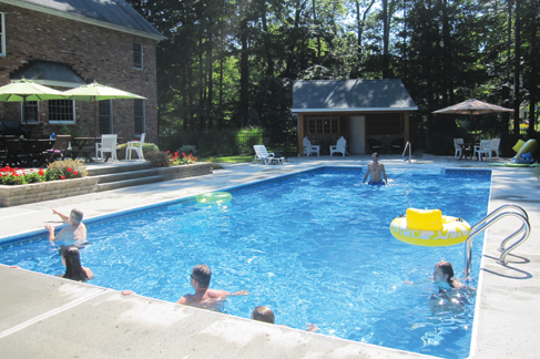 Fiberglass in-ground swimming pool installed by Waide's Swimming Pools & Spas in Erie, PA.